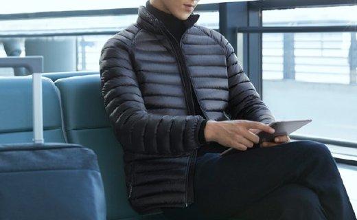 小米羽絨服:雙層結構防漏絨,700EP白鴨絨輕盈保暖